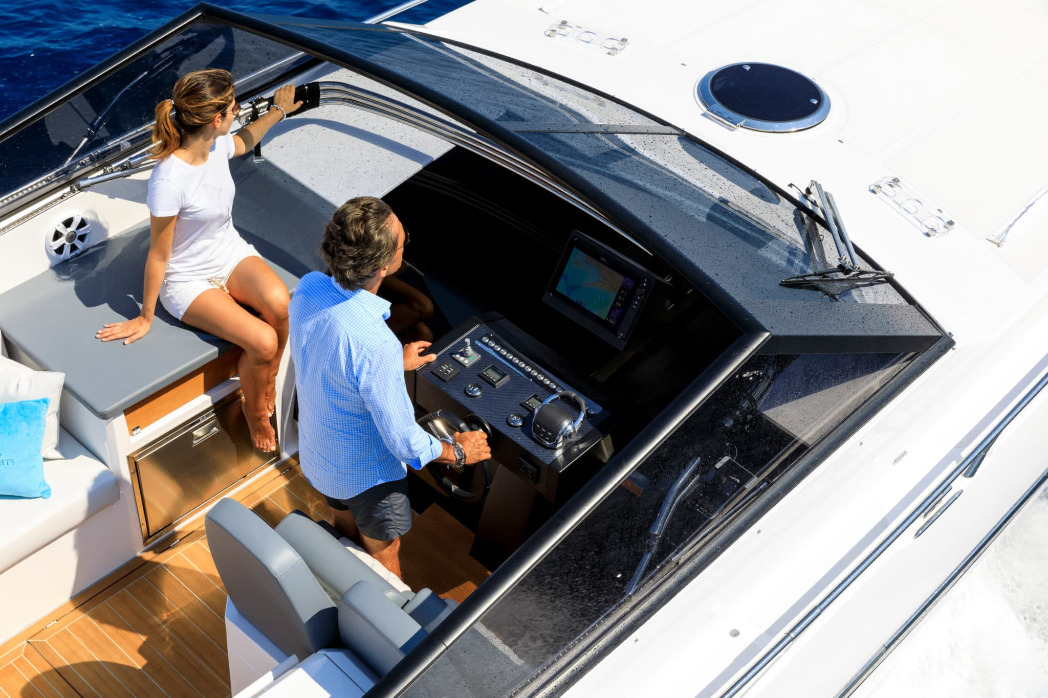 Aerial,View,Couple,On,Luxury,Motor,Boat
